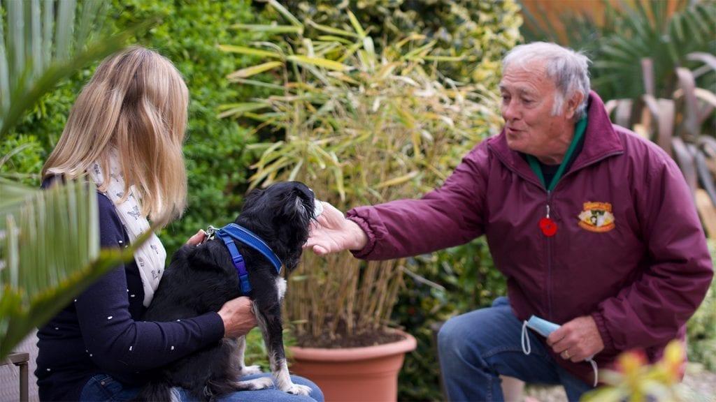 Volunteer, client and dog in the garden